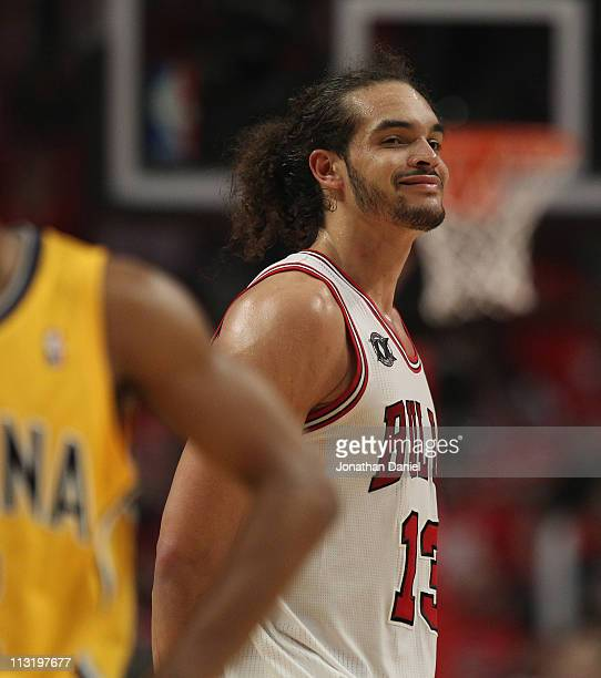 Joakim Noah of the Chicago Bulls smiles at family in the stands near the end of a win over the Indiana Pacers in Game Five of the Eastern Conference...