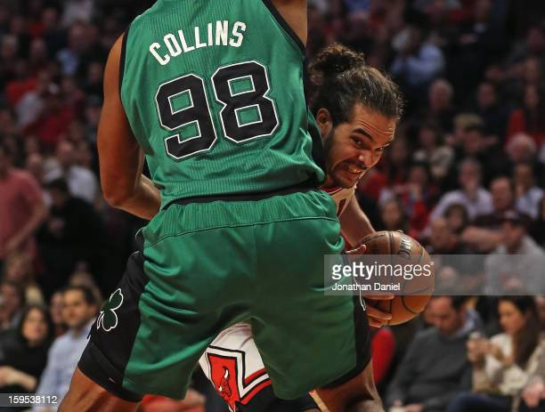 Joakim Noah of the Chicago Bulls tries to move against Jason Collins of the Boston Celtics at the United Center on December 18 2012 in Chicago...