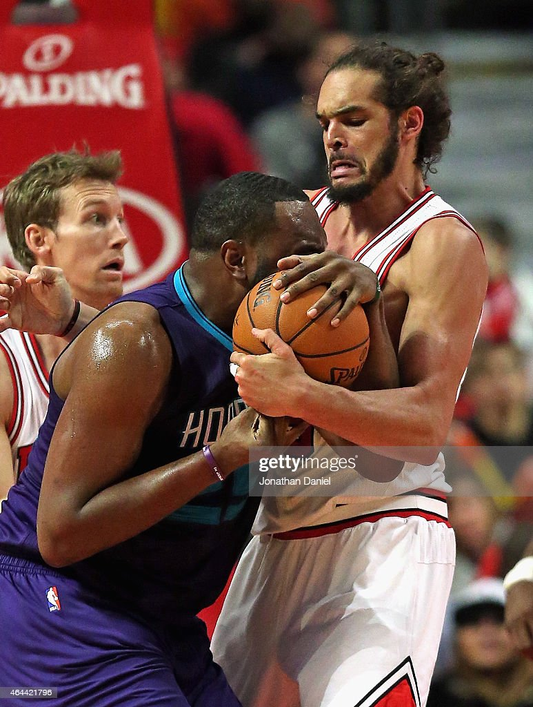 Joakim Noah #13 of the Chicago Bulls tries to take the ball away from Al Jefferson #25 of the Charlotte Hornets at the United Center on February 25, 2015 in Chicago, Illinois. The Hornets defeated the Bulls 98-86.