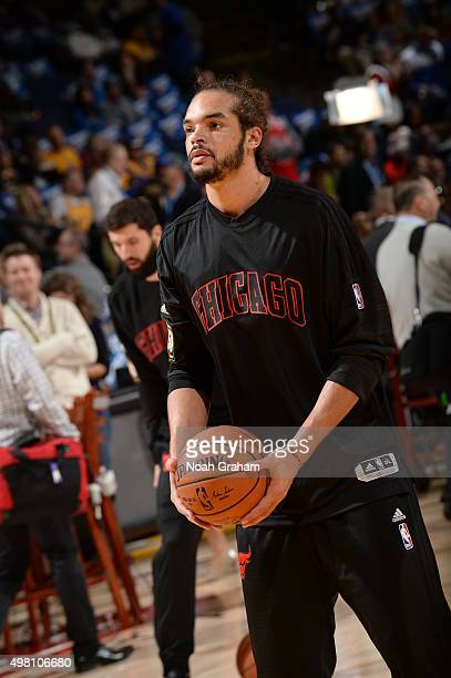Joakim Noah of the Chicago Bulls warms up before the game against the Golden State Warriors on November 20 2015 at ORACLE Arena in Oakland California...