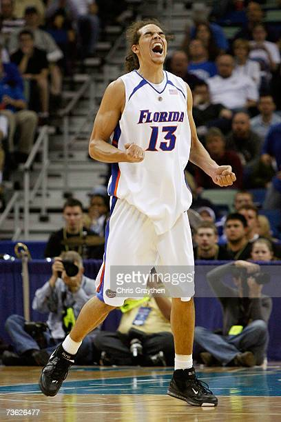 Joakim Noah of the Florida Gators celebrates during the second half against the Purdue Boilermakers in round two of the NCAA Men's Basketball...