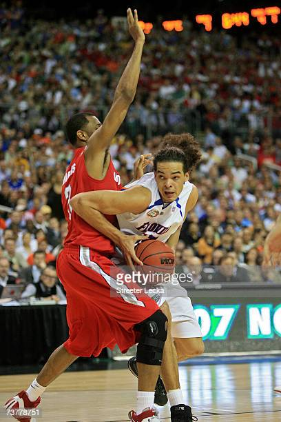 Joakim Noah of the Florida Gators handles the ball against Ivan Harris of the Ohio State Buckeyes during the NCAA Men's Basketball Championship game...
