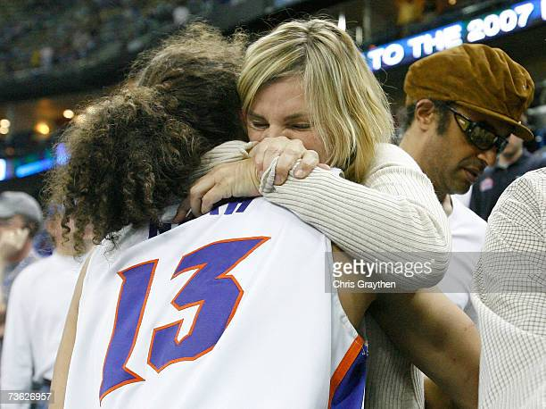Joakim Noah of the Florida Gators hugs his mother Cecilia Rodhe after defeating the Purdue Boilermakers 7467 in round two of the NCAA Men's...