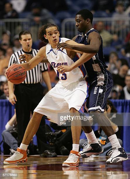 Joakim Noah of the Florida Gators moves the ball in the post against the Georgetown Hoyas during their Minneapolis Regional Semifinal of the 2006...