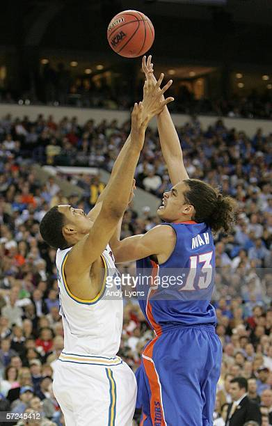 Joakim Noah of the Florida Gators shoots a hook shot over Ryan Hollins of the UCLA Bruins in the second half during the National Championship game of...