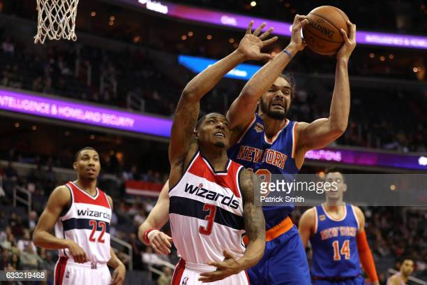 Joakim Noah of the New York Knicks and Bradley Beal of the Washington Wizards battle for a rebound during the first half at Verizon Center on January...