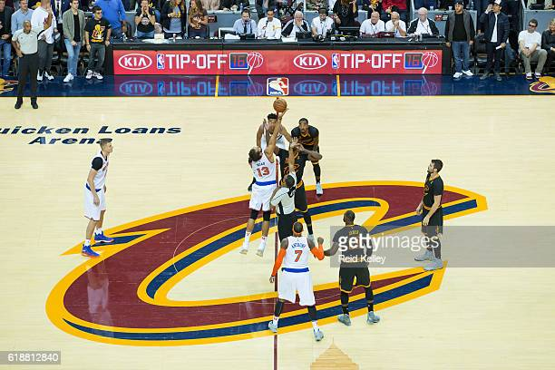 Joakim Noah of the New York Knicks and Tristan Thompson of the Cleveland Cavaliers go up for the opening tip off on October 25 2016 at Quicken Loans...