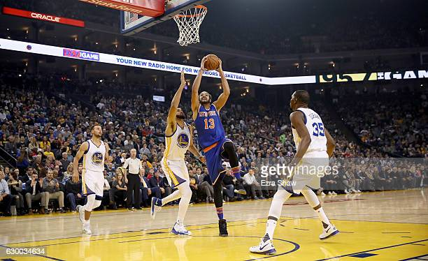 Joakim Noah of the New York Knicks goes up for a shot on JaVale McGee of the Golden State Warriors at ORACLE Arena on December 15 2016 in Oakland...