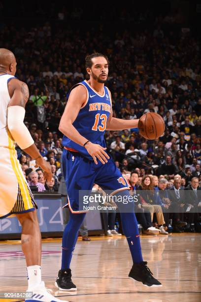 Joakim Noah of the New York Knicks handles the ball against the Golden State Warriors on January 23 2018 at ORACLE Arena in Oakland California NOTE...