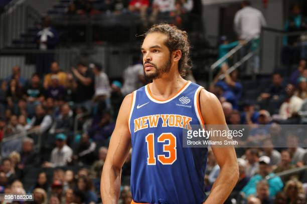 Joakim Noah of the New York Knicks looks on during the game against the Charlotte Hornets on December 18 2017 at Spectrum Center in Charlotte North...