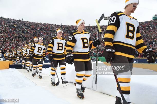 Joakim Nordstrom Noel Acciari and Colby Cave of the Boston Bruins and teammates make their way to the ice surface prior to the 2019 Bridgestone NHL...