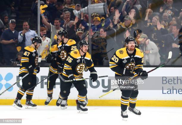 Joakim Nordstrom of the Boston Bruins is congratulated by his teammates after scoring a first period goal against the St Louis Blues in Game Two of...