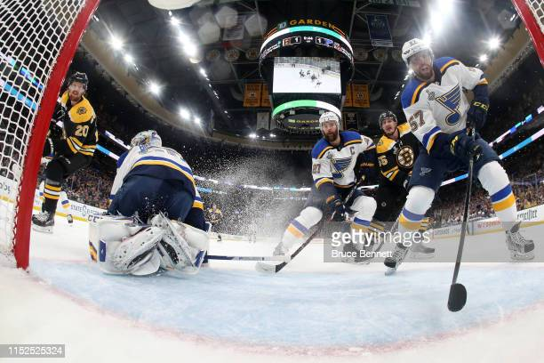 Joakim Nordstrom of the Boston Bruins scores a first period goal past Jordan Binnington of the St Louis Blues as David Perron reacts in Game Two of...