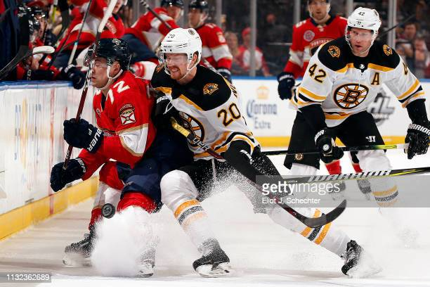 Joakim Nordstrom of the Boston Bruins tangles with Frank Vatrano of the Florida Panthers at the BBT Center on March 23 2019 in Sunrise Florida