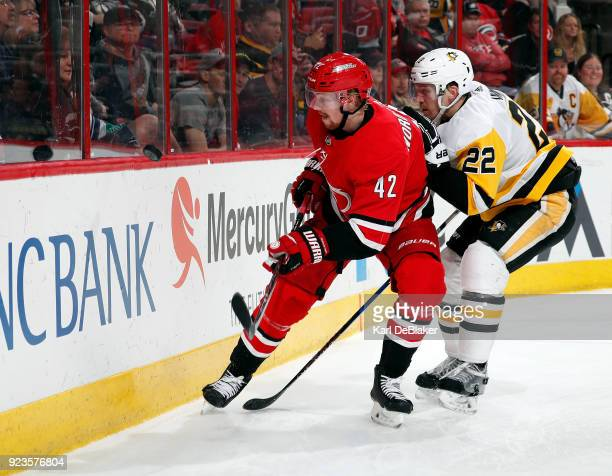 Joakim Nordstrom of the Carolina Hurricanes and Matt Hunwick of the Pittsburgh Penguins chase a puck into the endboards during an NHL game on...
