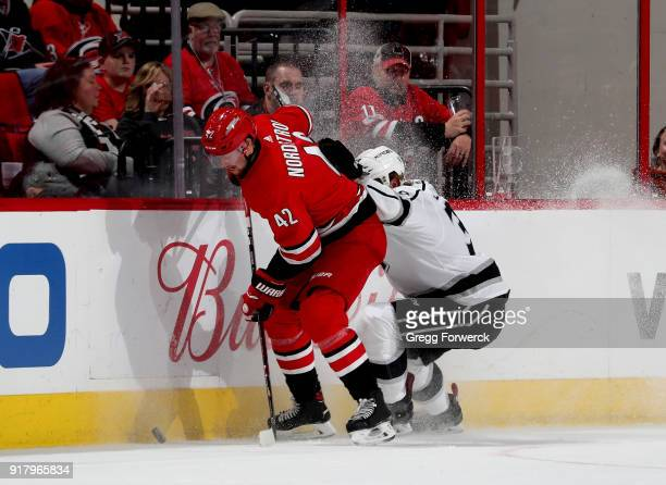 Joakim Nordstrom of the Carolina Hurricanes and Paul LaDue of the Los Angeles Kings battle along the boards for the loose puck during an NHL game on...