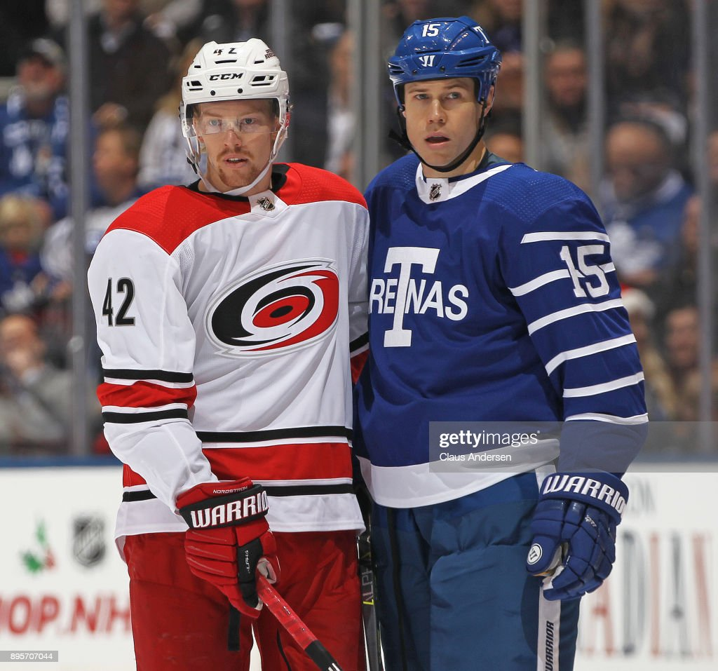 Joakim Nordstrom #42 of the Carolina Hurricanes stands with Matt Martin #15 of the Toronto Maple Leafs during a fight in an NHL game at the Air Canada Centre on December 19, 2017 in Toronto, Ontario, Canada. The Maple Leafs defeated the Hurricanes 8-1.
