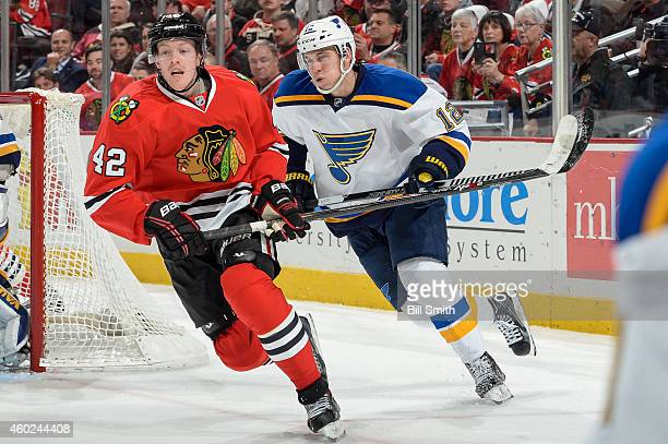 Joakim Nordstrom of the Chicago Blackhawks and Jori Lehtera of the St. Louis Blues skate by the net during the NHL game at the United Center on...