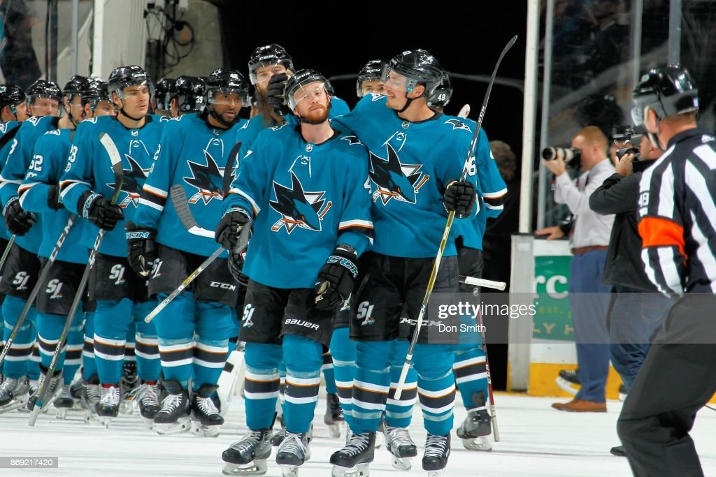 Joakim Ryan #47 and Justin Braun #61 of the San Jose Sharks share moment after the Sharks win a game against the Nashville Predators at SAP Center on November 1, 2017 in San Jose, California. The Sharks defeated the Predators 4-1.