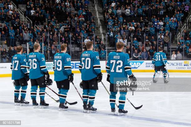 Joakim Ryan Jannik Hansen Logan Couture Chris Tierney and Tim Heed of the San Jose Sharks line up for the national anthem of the game against the...