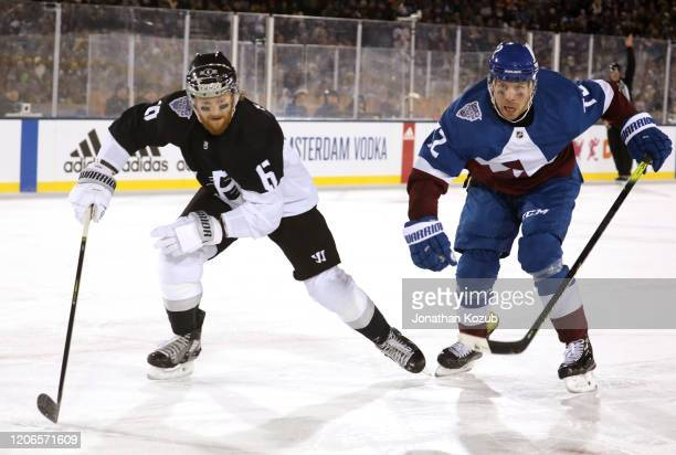 Joakim Ryan of the Los Angeles Kings and Joonas Donskoi of the Colorado Avalanche skate during the third period of the 2020 NHL Stadium Series game...