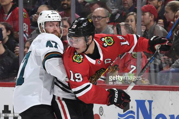 Joakim Ryan of the San Jose Sharks and Jonathan Toews of the Chicago Blackhawks get physical in the third period at the United Center on February 23...