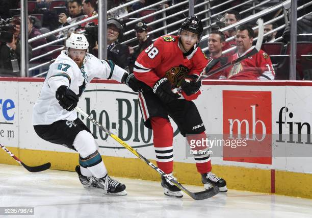 Joakim Ryan of the San Jose Sharks and Patrick Kane of the Chicago Blackhawks watch for the puck in the third period at the United Center on February...