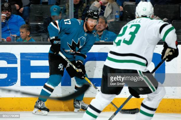 Joakim Ryan of the San Jose Sharks controls the puck in front of Esa Lindell of the Dallas Stars at SAP Center on February 18 2018 in San Jose...