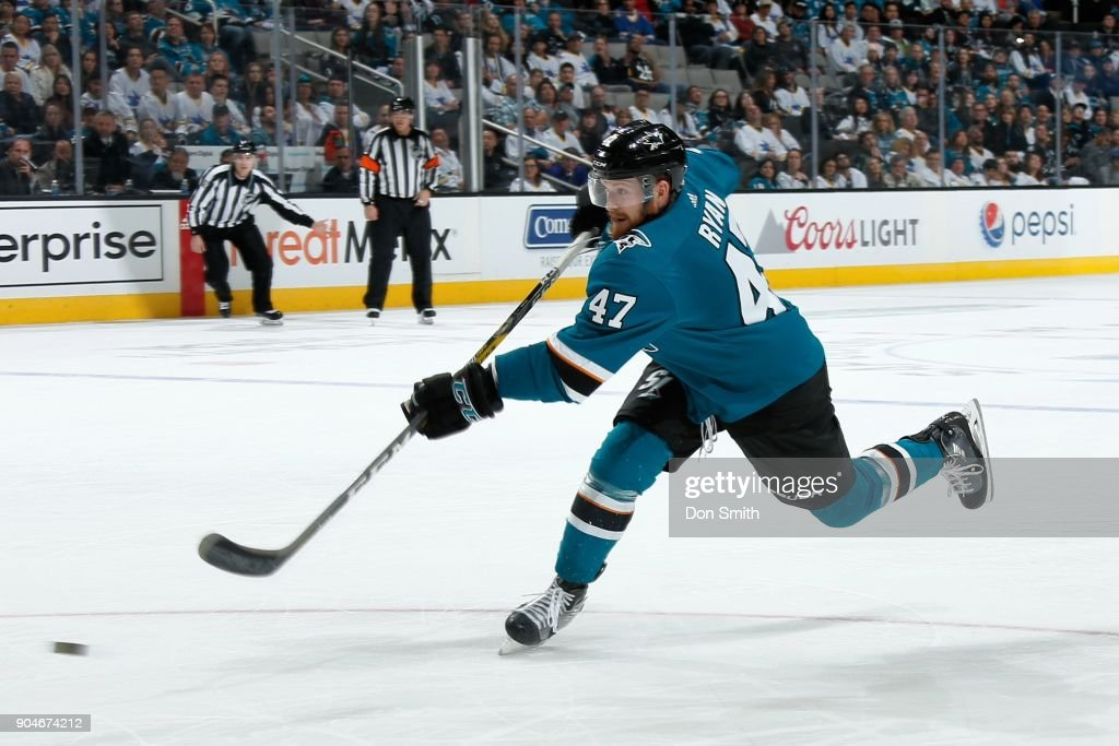 Joakim Ryan #47 of the San Jose Sharks fires off the puck during a NHL game against the Arizona Coyotes at SAP Center on January 13, 2018 in San Jose, California.