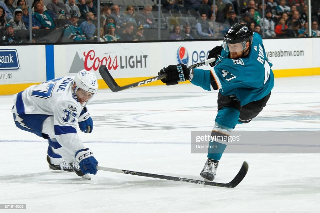 Joakim Ryan #47 of the San Jose Sharks fires the puck by Yanni Gourde #37 of the Tampa Bay Lightning at SAP Center on November 8, 2017 in San Jose, California.