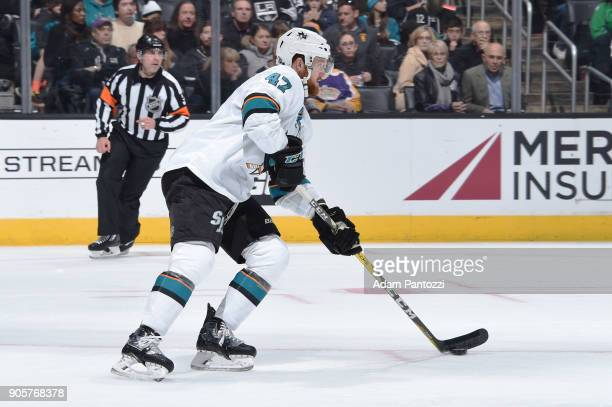 Joakim Ryan of the San Jose Sharks handles the puck during a game against the Los Angeles Kings at STAPLES Center on January 15 2018 in Los Angeles...