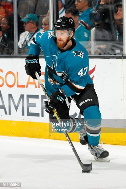 Joakim Ryan of the San Jose Sharks handles the puck during a NHL game against the Arizona Coyotes at SAP Center on February 13 2018 in San Jose...