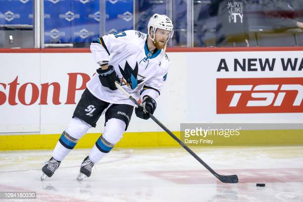 Joakim Ryan of the San Jose Sharks take part in the pregame warm up prior to NHL action against the Winnipeg Jets at the Bell MTS Place on February 5...