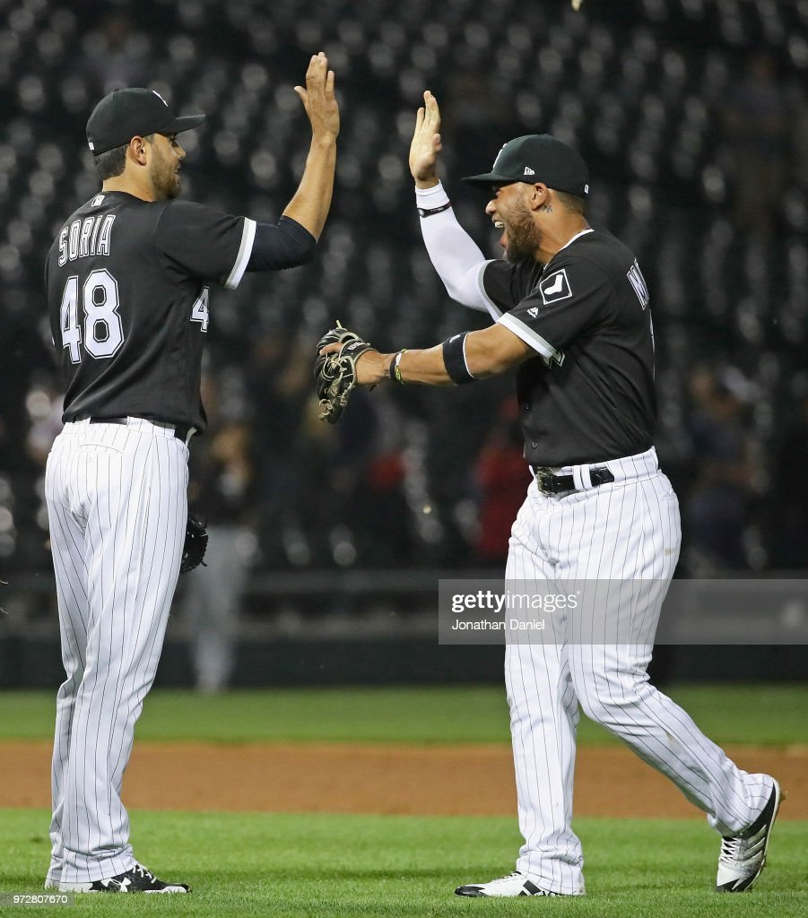 Joakim Soria #48 (L) and Yoan Moncada #10 of the Chicago White Sox celebrate a win over the Cleveland Indians at Guaranteed Rate Field on June 12, 2018 in Chicago, Illinois. The White Sox defeated the Indians 5-1.