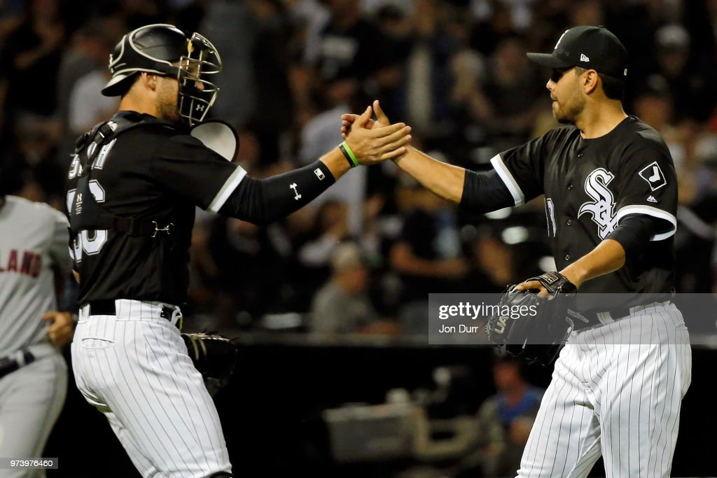 Joakim Soria #48 of the Chicago White Sox (R) and Kevan Smith #36 (L) celebrate their win against the Cleveland Indians at Guaranteed Rate Field on June 13, 2018 in Chicago, Illinois. The Chicago White Sox won 3-2.