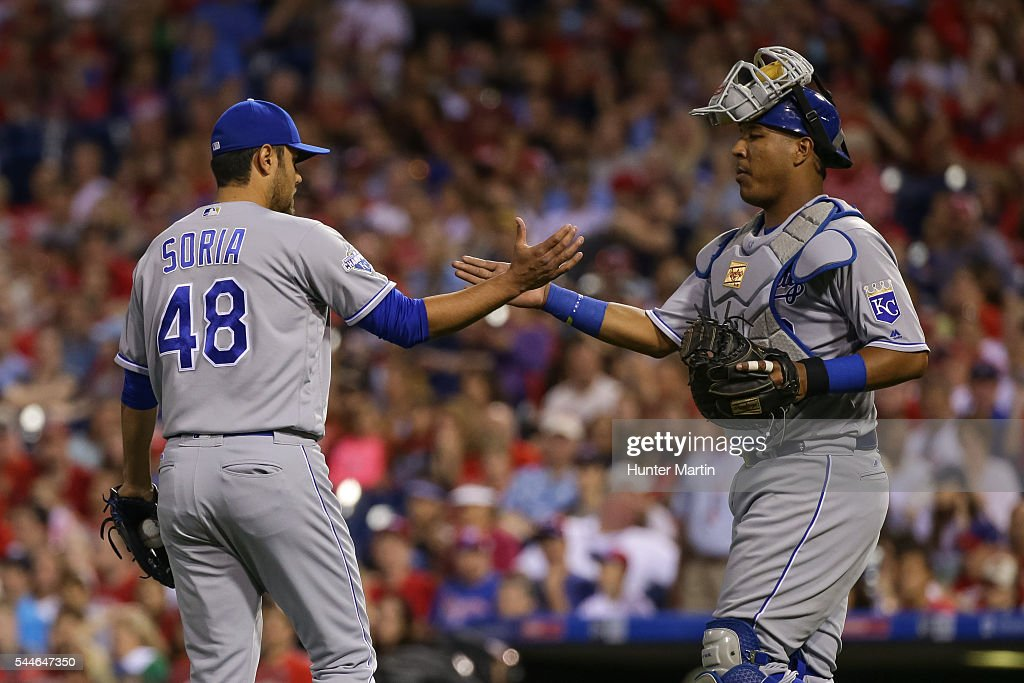 Joakim Soria #48 of the Kansas City Royals is congratulated by Salvador Perez #13 after closing out a victory against the Philadelphia Phillies at Citizens Bank Park on July 2, 2016 in Philadelphia, Pennsylvania. The Royals won 6-2.