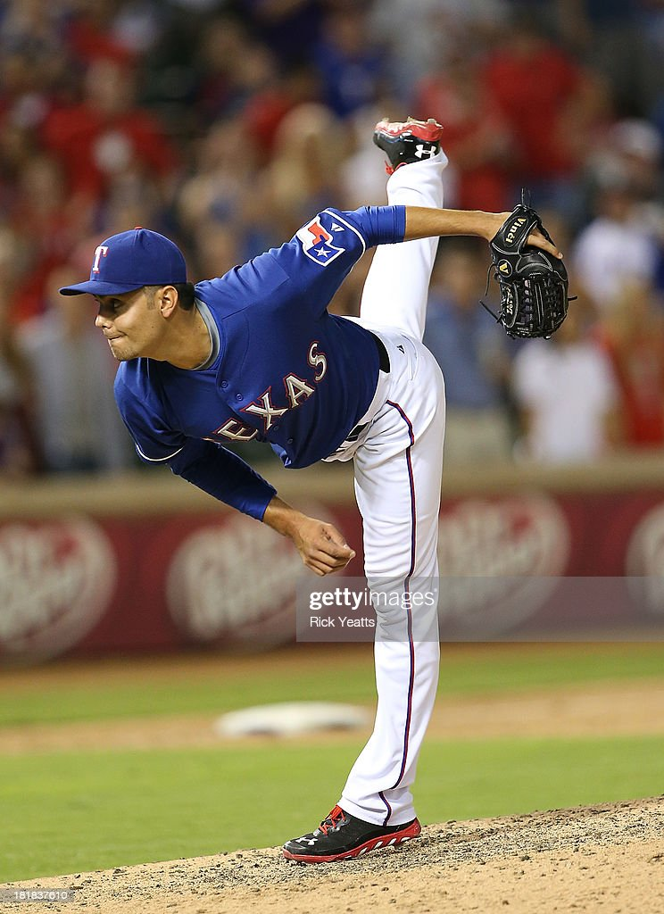 Joakim Soria #28 of the Texas Rangers throws in the ninth inning to close out the game for the win against the Houston Astros at Rangers Ballpark in Arlington on September 25, 2013 in Arlington, Texas.