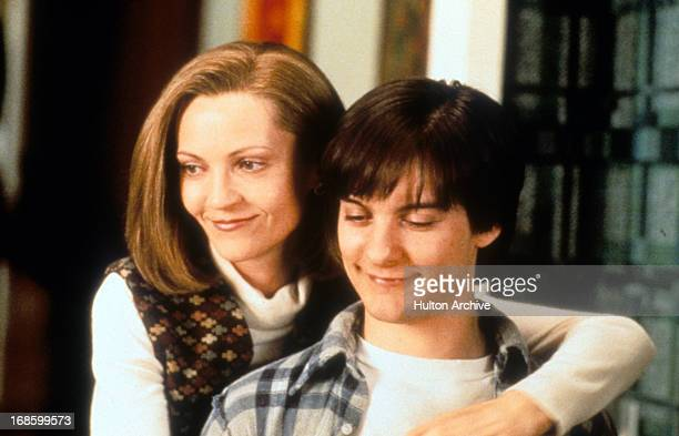 Joan Allen with her arms around Tobey Maguire in a scene from the film 'The Ice Storm' 1997
