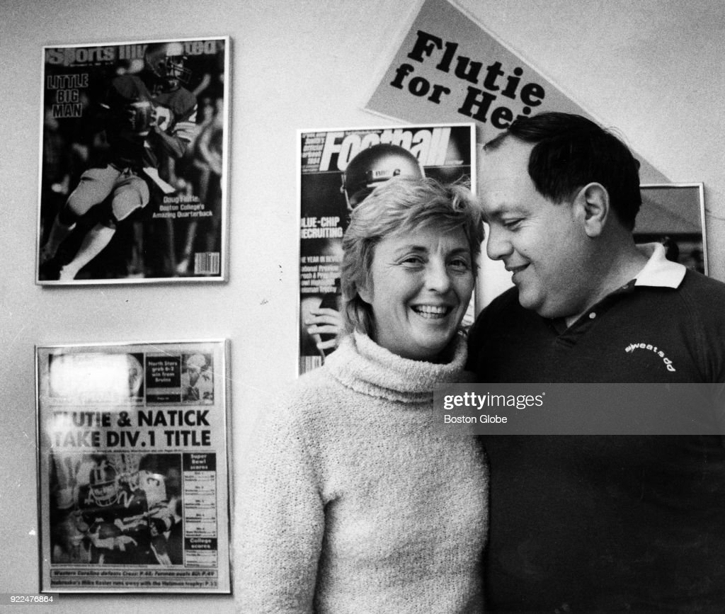 Joan and Dick Flutie, parents of Doug Flutie, pose for a photo inside their home in Natick, Mass., Nov. 27, 1984.