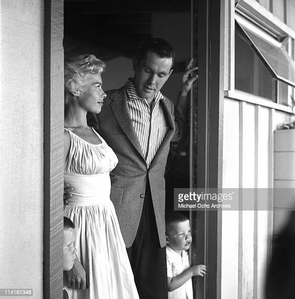 Joan and Johnny Carson host of The Johnny Carson Show on CBS at home with one of their three sons on July 5 1956 in Los Angeles California