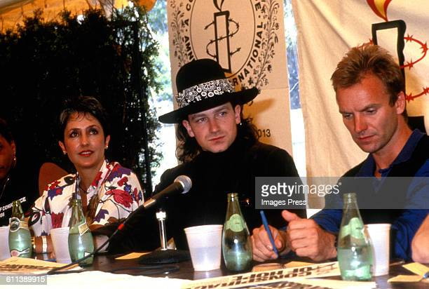 Joan Baez Bono and Sting talk to the press at the Amnesty International Concert at Giants Stadium circa 1986 in East Rutherford New Jersey