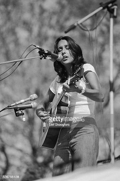 Joan Baez sings and plays the guitar while she performs in Central Park for a group of antiwar activists who celebrate the end of the Vietnam War New...