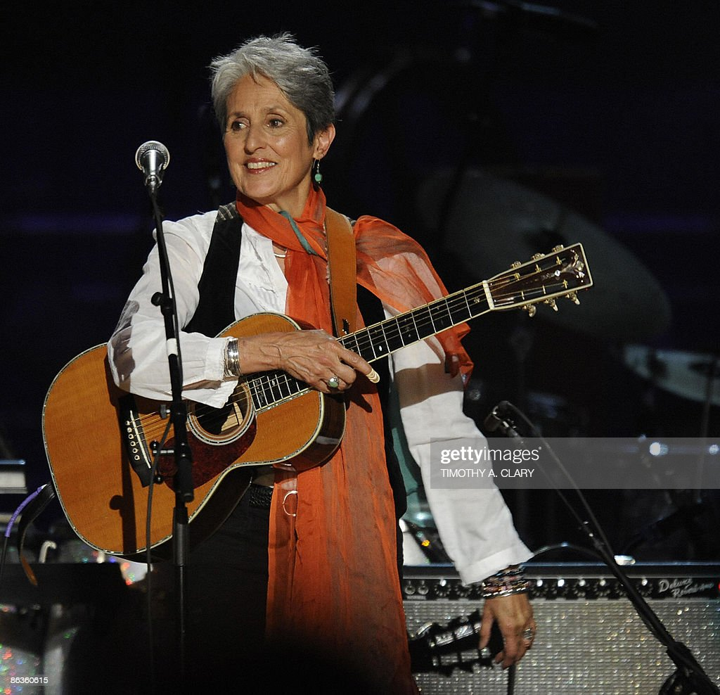 Joan Baez smiles during a concert for folk music legend Pete Seeger at Madison Square Garden in Nedw York on May 3, 2009 marking his 90th birthday. Proceeds from the show will go to Hudson River Sloop Clearwater, an organization founded by the singer 40 years ago to preserve and protect the Hudson River.