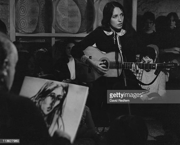 Joan Baez US folk singer playing an acoustic guitar while performing on a television show in London England Great Britain circa 1965