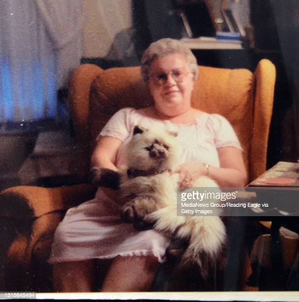 Joan Beiler for Not Forgotten. Copy photo of Joan holding a stuffed toy cat. 10/12/15 photo by Tim Leedy