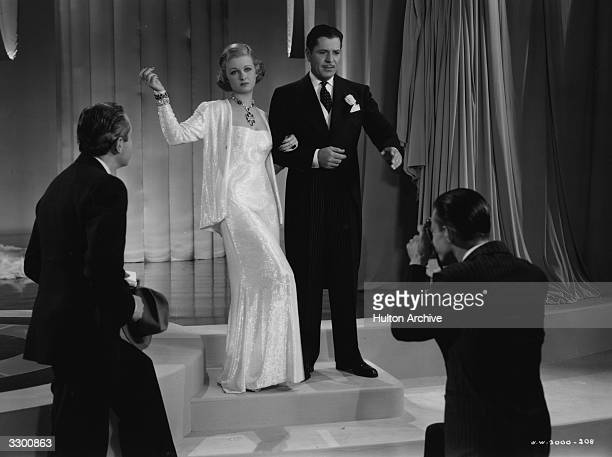 Joan Bennett and Warner Baxter in a scene from 'Vogues of 1938' where rival fashion houses compete at the Seven Arts Ball The film was directed by...