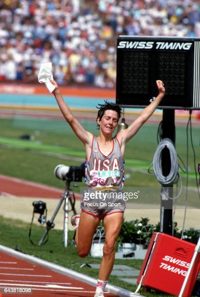 Joan Benoit of the United States celebrates after winning the Women's Marathon during the Games of the XXIII Olympiad in the 1984 Summer Olympics...