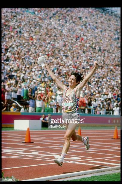 Joan Benoit of the United States raises her arms into the air as she crosses the finish line of the women''s marathon during the 1984 Summer Olympics...