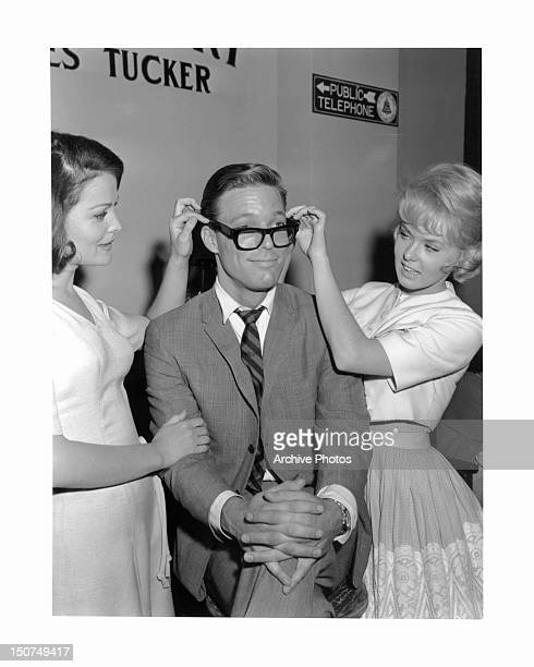 Joan Blackman and Joey Heatherton adjust Richard Chamberlain's glasses in promotion for the film 'Twilight Of Honor' 1963
