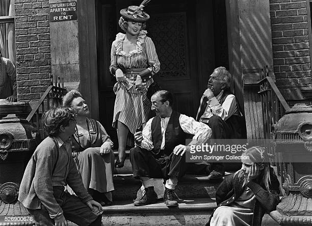 Joan Blondell as Sissy Edwards Ted Donaldson as Neeley Nolan and Peggy Ann Garner as Francie Nolan in the 1945 film A Tree Grows in Brooklyn